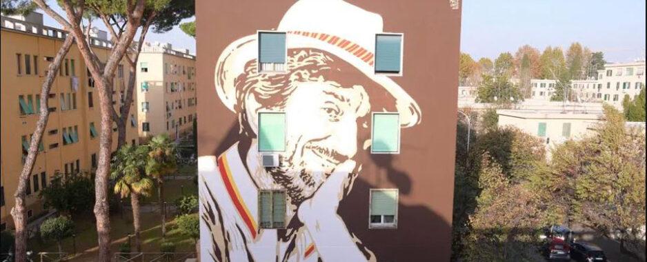 Roma, al Tufello il murale dedicato a Gigi Proietti a firma di Lucamaleonte